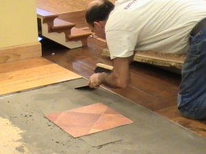 Using patching compound and flooring to gauge thickness for a flush fit.