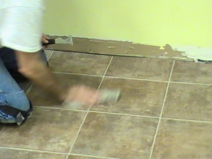 Earl is quick! Cleaning off the seam after inserting sealer.