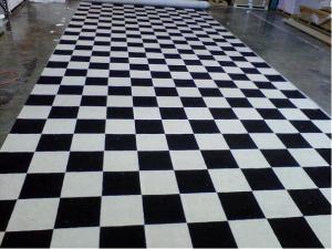 black and white checkerboard flooring custom rug installation