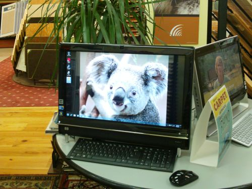 image of two computers for customer use in retail showroom in dc area alexandria carpet one